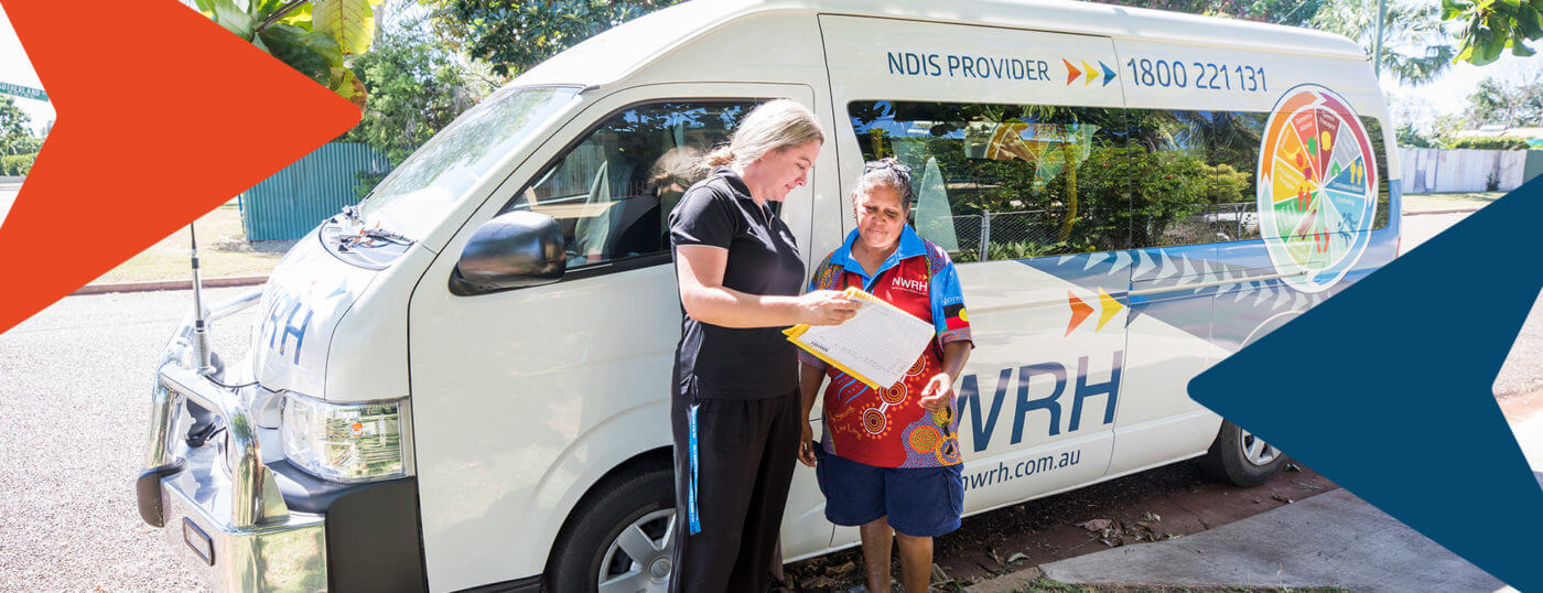 NWRH staff members against the backdrop of a NWRH van discuss the day's activities.
