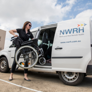 NWRH Townsville, Equipment Van staff member putting a wheelchair into a van.